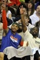 Apr 12, 2013; Cleveland, OH, USA; New York Knicks small forward Carmelo Anthony (left) and  point guard Raymond Felton celebrate on the bench in the fourth quarter against the Cleveland Cavaliers at Quicken Loans Arena. Mandatory Credit: David Richard-USA TODAY Sports
