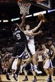 Apr 12, 2013; San Antonio, TX, USA; San Antonio Spurs guard Nando De Colo (25) drives to the basket as Sacramento Kings forward Patrick Patterson (9) defends during the first half at the AT&T Center. Mandatory Credit: Soobum Im-USA TODAY Sports