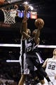 Apr 12, 2013; San Antonio, TX, USA; Sacramento Kings guard Isaiah Thomas (22) drives to the basket under pressure from San Antonio Spurs forward Tim Duncan (behind) during the second half at the AT&T Center. Mandatory Credit: Soobum Im-USA TODAY Sports