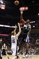 Apr 12, 2013; San Antonio, TX, USA; Sacramento Kings forward Patrick Patterson (9) takes a shot over San Antonio Spurs forward Matt Bonner (15) during the second half at the AT&T Center. Mandatory Credit: Soobum Im-USA TODAY Sports