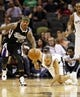 Apr 12, 2013; San Antonio, TX, USA; Sacramento Kings guard Isaiah Thomas (22) and San Antonio Spurs guard Tony Parker (right) chase a loose ball during the second half at the AT&T Center. Mandatory Credit: Soobum Im-USA TODAY Sports