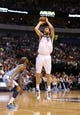 April 12, 2013; Dallas, TX, USA;  Dallas Mavericks forward Dirk Nowitzki (41) makes a three point basket in the second quarter against the Denver Nuggets at the American Airlines Center. Mandatory Credit: Matthew Emmons-USA TODAY Sports