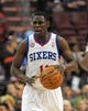 Apr 14, 2013; Philadelphia, PA, USA; Philadelphia 76ers point guard Jrue Holiday (11) brings the ball up court against the Cleveland Cavaliers during the first quarter at the Wells Fargo Center. Mandatory Credit: Eric Hartline-USA TODAY Sports