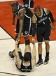 Apr 14, 2013; Toronto, ON, Canada; Brooklyn Nets point guard Deron Williams (8) is helped up by center Andray Blatche (0) and point guard C.J. Watson (1) after being fouled against the Toronto Raptors at the Air Canada Centre. The Raptors beat the Nets 93-87. Mandatory Credit: Tom Szczerbowski-USA TODAY Sports