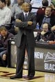 Apr 15, 2013; Cleveland, OH, USA; Cleveland Cavaliers head coach Byron Scott stands on the sideline in the fourth quarter against the Miami Heat at Quicken Loans Arena. Mandatory Credit: David Richard-USA TODAY Sports