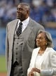 Apr 15, 2013; Los Angeles, CA, USA; Los Angeles Dodgers co-owner Magic Johnson (left) and Rachel Robinson (the wife of the late Jackie Robinson) attend the game against the San Diego Padres at Dodger Stadium. Mandatory Credit: Kirby Lee-USA TODAY Sports
