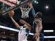 Apr 15, 2013; Minneapolis, MN, USA; Minnesota Timberwolves power forward Derrick Williams (7) shoots and Utah Jazz power forward Paul Millsap (24) defends in the second quarter at Target Center. The Jazz won 96-80. Mandatory Credit:  Greg Smith-USA TODAY Sports