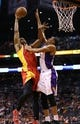 Apr. 15, 2013; Phoenix, AZ, USA: Phoenix Suns forward Wesley Johnson (right) blocks the shot of Houston Rockets forward Terrence Jones in the second quarter at the US Airways Center. Mandatory Credit: Mark J. Rebilas-USA TODAY Sports