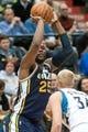 Apr 15, 2013; Minneapolis, MN, USA; Utah Jazz center Al Jefferson (25) shoots the ball and Minnesota Timberwolves center Greg Stiemsma (34) defends in the second quarter at Target Center. The Jazz won 96-80. Mandatory Credit:  Greg Smith-USA TODAY Sports