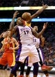 Apr. 15, 2013; Phoenix, AZ, USA: Phoenix Suns forward P.J. Tucker (17) reaches for a rebound in the second half against the Houston Rockets at the US Airways Center. The Suns defeated the Rockets 119-112. Mandatory Credit: Mark J. Rebilas-USA TODAY Sports