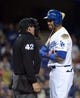 Apr 15, 2013; Los Angeles, CA, USA; Los Angeles Dodgers center fielder Matt Kemp (right) argues with home plate umpire Paul Schrieber after striking out against the San Diego Padres at Dodger Stadium. Mandatory Credit: Kirby Lee-USA TODAY Sports