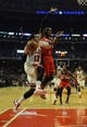 Apr 17, 2013; Chicago, IL, USA; Chicago Bulls shooting guard Kirk Hinrich (12) is defended by Washington Wizards point guard John Wall (2) during the first half at the United Center. Mandatory Credit: David Banks-USA TODAY Sports