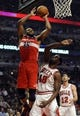Apr 17, 2013; Chicago, IL, USA; Washington Wizards power forward Trevor Booker (35) shoots over Chicago Bulls center Nazr Mohammed (48) during the first half at the United Center. Mandatory Credit: David Banks-USA TODAY Sports