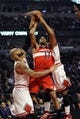 Apr 17, 2013; Chicago, IL, USA; Washington Wizards shooting guard Garrett Temple (17) is defended by Chicago Bulls power forward Carlos Boozer (5) and small forward Jimmy Butler (21) at the United Center. Mandatory Credit: David Banks-USA TODAY Sports