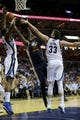 Apr 17, 2013; Memphis, TN, USA;  Utah Jazz center Al Jefferson (25) shoots the ball against Memphis Grizzlies power forward Ed Davis (32) and center Marc Gasol (33) during the game at FedEx Forum.  Mandatory Credit: Spruce Derden   USA TODAY Sports