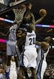 Apr 17, 2013; Memphis, TN, USA;  Utah Jazz power forward Paul Millsap (24) shoots the ball against Memphis Grizzlies power forward Ed Davis (32) during the game at FedEx Forum.  Mandatory Credit: Spruce Derden   USA TODAY Sports