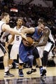 Apr 17, 2013; San Antonio, TX, USA; Minnesota Timberwolves  guard Jose Barea (center) splits the defense of San Antonio Spurs forward Aron Baynes (left) and forward DeJuan Blair (right) during the first half at the AT&T Center. Mandatory Credit: Soobum Im-USA TODAY Sports