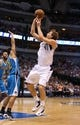 Apr 17, 2013; Dallas, TX, USA; Dallas Mavericks forward Dirk Nowitzki (41) shoots while getting fouled by New Orleans Hornets guard Brian Roberts (22) at American Airlines Center. Mandatory Credit: Matthew Emmons-USA TODAY Sports