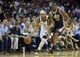 Apr 17, 2013; Memphis, TN, USA;  Memphis Grizzlies point guard Jerryd Bayless (7) brings the ball up court against Utah Jazz point guard Alec Burks (10) during the game at FedEx Forum.  The Memphis Grizzlies defeated the Utah Jazz 86-70.  Mandatory Credit: Spruce Derden   USA TODAY Sports