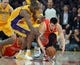 Apr 17, 2013; Los Angeles, CA, USA; Houston Rockets guard Jeremy Lin (7) is defended by Los Angeles Lakers forward Antawn Jamison (4) at the Staples Center. The Lakers defeated the Rockets 99-95 in overtime. Mandatory Credit: Kirby Lee-USA TODAY Sports