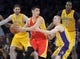 Apr 17, 2013; Los Angeles, CA, USA; Houston Rockets guard Jeremy Lin (7) is defended by Los Angeles Lakers guard Steve Blake (5) at the Staples Center. The Lakers defeated the Rockets 99-95 in overtime. Mandatory Credit: Kirby Lee-USA TODAY Sports