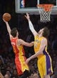 Apr 17, 2013; Los Angeles, CA, USA; Houston Rockets forward Chandler Parsons (25) is defended by Los Angeles Lakers forward Pau Gasol (16) at the Staples Center. The Lakers defeated the Rockets 99-95 in overtime. Mandatory Credit: Kirby Lee-USA TODAY Sports