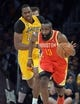 Apr 17, 2013; Los Angeles, CA, USA; Houston Rockets guard James Harden (13) dribbles the ball with Los Angeles Lakers center Dwight Howard (12) in pursuit at the Staples Center. Mandatory Credit: Kirby Lee-USA TODAY Sports