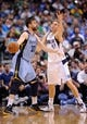 Apr 15, 2013; Dallas, TX, USA; Dallas Mavericks power forward Dirk Nowitzki (41) guards Memphis Grizzlies center Marc Gasol (33) during the game at the American Airlines Center. Mandatory Credit: Jerome Miron-USA TODAY Sports