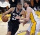 Apr 28, 2013; Los Angeles, CA, USA; San Antonio Spurs power forward Tim Duncan (21) drives to the basket on Los Angeles Lakers power forward Pau Gasol (16) during 4th quarter action in game four of the first round of the 2013 NBA playoffs at the Staples Center. Mandatory Credit: Robert Hanashiro-USA TODAY Sports