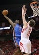 May 3, 2013; Houston, TX, USA; Oklahoma City Thunder point guard Reggie Jackson (15) attempts to score a basket during the third quarter as Houston Rockets center Omer Asik (3) defends in game six of the first round of the 2013 NBA Playoffs at the Toyota Center. Mandatory Credit: Troy Taormina-USA TODAY Sports
