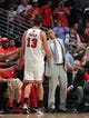 May 10, 2013; Chicago, IL, USA; Chicago Bulls point guard Derrick Rose (street clothes) shakes the hand of Chicago Bulls center Joakim Noah (13) after Noah fouled out in the second half of game three of the second round of the 2013 NBA Playoffs against the Miami Heat at the United Center. Miami won 104-94. Mandatory Credit: Dennis Wierzbicki-USA TODAY Sports