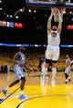May 2, 2013; Oakland, CA, USA; Golden State Warriors center Andrew Bogut (12) dunks against the Denver Nuggets during the second quarter of game six of the first round of the 2013 NBA Playoffs at Oracle Arena. The Warriors defeated the Nuggets 92-88. Mandatory Credit: Kyle Terada-USA TODAY Sports