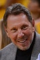 May 2, 2013; Oakland, CA, USA; Oracle co-founder Larry Ellison smiles while sitting courtside during the fourth quarter of game six of the first round of the 2013 NBA Playoffs between the Golden State Warriors and the Denver Nuggets at Oracle Arena. The Warriors defeated the Nuggets 92-88. Mandatory Credit: Kyle Terada-USA TODAY Sports