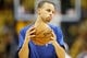 Apr 20, 2013; Denver, CO, USA;  Golden State Warriors guard Stephen Curry (30) warms up before game one of the first round of the 2013 NBA Playoffs against the Denver Nuggets at the Pepsi Center. Mandatory Credit: Chris Humphreys-USA TODAY Sports