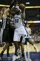 May 25, 2013; Memphis, TN, USA; Memphis Grizzlies power forward Zach Randolph (50) drives to the basket against San Antonio Spurs power forward Matt Bonner (15) in game three of the Western Conference finals of the 2013 NBA Playoffs at FedEx Forum. San Antonio Spurs defeat the Memphis Grizzlies 104-93, and lead the series 3-0.  Mandatory Credit: Spruce Derden-USA TODAY Sports