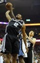 May 27, 2013; Memphis, TN, USA; San Antonio Spurs small forward Kawhi Leonard (2) reaches back for the ball against the Memphis Grizzlies in the second half of game four of the Western Conference finals of the 2013 NBA Playoffs at FedEx Forum.  The Spurs won 93-86.  Mandatory Credit: Spruce Derden-USA TODAY Sports