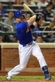 Jun 14, 2013; New York, NY, USA; New York Mets third baseman David Wright (5) hits a single against the Chicago Cubs during the seventh inning of a game at Citi Field. Mandatory Credit: Brad Penner-USA TODAY Sports