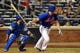 Jun 14, 2013; New York, NY, USA; New York Mets first baseman Daniel Murphy (28) hits an RBI single against the Chicago Cubs during the seventh inning of a game at Citi Field. Mandatory Credit: Brad Penner-USA TODAY Sports