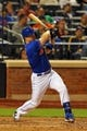 Jun 14, 2013; New York, NY, USA; New York Mets third baseman David Wright (5) hits a single against the Chicago Cubs during the fifth inning of a game at Citi Field. Mandatory Credit: Brad Penner-USA TODAY Sports