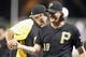 Jun 14, 2013; Pittsburgh, PA, USA; Pittsburgh Pirates relief pitcher Jason Grilli (39) shakes hands with manager Clint Hurdle (left) after the final out against the Los Angeles Dodgers during the ninth inning at PNC Park. The Pittsburgh Pirates won 3-0. Mandatory Credit: Charles LeClaire-USA TODAY Sports