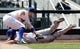 Jun 15, 2013; Flushing, NY,USA;  Chicago Cubs starting pitcher Scott Feldman (46) is safe at third as New York Mets third baseman David Wright (5) is late with the tag during the fourth inning at Citi Field.  Mandatory Credit: Anthony Gruppuso-USA TODAY Sports