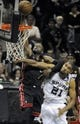 Jun 16, 2013; San Antonio, TX, USA;  Miami Heat shooting guard Dwyane Wade (3) is fouled by San Antonio Spurs power forward Tim Duncan (21) during the fourth quarter of game five in the 2013 NBA Finals at the AT&T Center. Mandatory Credit: Brendan Maloney-USA TODAY Sports