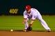 Jun 17, 2013; St. Louis, MO, USA; St. Louis Cardinals second baseman Matt Carpenter (13)fields the ball against the Chicago Cubs at Busch Stadium. Mandatory Credit: Scott Rovak-USA TODAY Sports