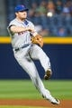 June 17, 2012; Atlanta, GA, USA; New York Mets second baseman Daniel Murphy (28) throws to first for an out in the fourth inning against the Atlanta Braves at Turner Field. Mandatory Credit: Daniel Shirey-USA TODAY Sports