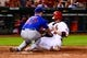 Jun 17, 2013; St. Louis, MO, USA; St. Louis Cardinals catcher Yadier Molina (4) scores as Chicago Cubs starting pitcher Travis Wood (37) attempts the tag during the seventh inning at Busch Stadium. Mandatory Credit: Scott Rovak-USA TODAY Sports