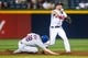 June 17, 2012; Atlanta, GA, USA; Atlanta Braves second baseman Dan Uggla (26) turns a double play over New York Mets second baseman Daniel Murphy (28) in the fifth inning at Turner Field. Mandatory Credit: Daniel Shirey-USA TODAY Sports