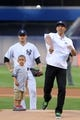 Jun 19, 2013; Bronx, NY, USA; New York Yankees starting pitcher Phil Hughes (65) watches as Brooklyn Nets head coach Jason Kidd and his son Chance throw out the ceremonial first pitch before the start of a game between the New York Yankees and the Los Angeles Dodgers at Yankee Stadium. Mandatory Credit: Brad Penner-USA TODAY Sports