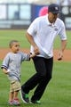 Jun 19, 2013; Bronx, NY, USA; Brooklyn Nets head coach Jason Kidd and his son Chance after throwing out the ceremonial first pitch before the start of a game between the New York Yankees and the Los Angeles Dodgers at Yankee Stadium. Mandatory Credit: Brad Penner-USA TODAY Sports