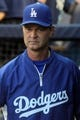 Jun 19, 2013; Bronx, NY, USA; Los Angeles Dodgers manager Don Mattingly (8) in the dugout before the start of the second game of a doubleheader against the New York Yankees at Yankee Stadium. Mandatory Credit: Brad Penner-USA TODAY Sports
