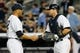 Jun 21, 2013; Bronx, NY, USA;  New York Yankees relief pitcher Mariano Rivera (42) and catcher Austin Romine (53) celebrate the win against the Tampa Bay Rays at Yankee Stadium.  Yankees won 6-2.  Mandatory Credit: Anthony Gruppuso-USA TODAY Sports